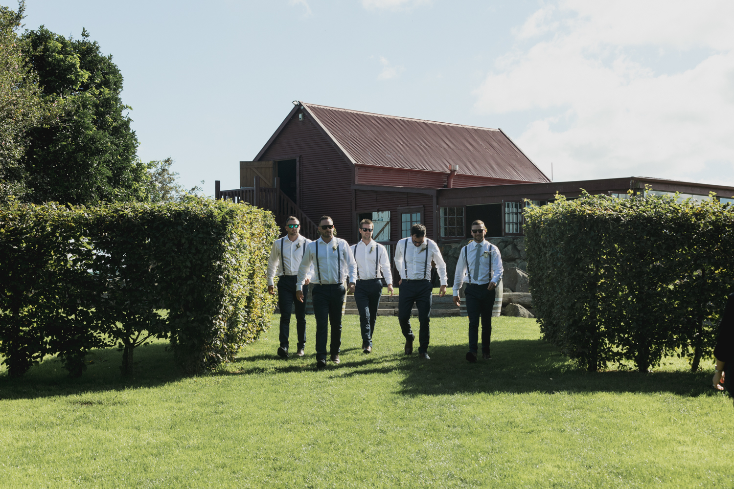 wedding-at-the-red-barn-new-zealand-wedding-photographer-groom-with-groomsmen-arriving-at-ceremony.jpg
