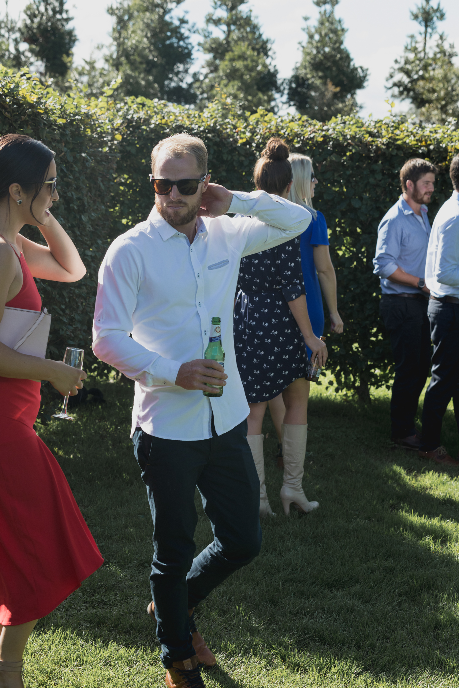 wedding-at-the-red-barn-new-zealand-wedding-photographer-guests-arriving-at-ceremony.jpg