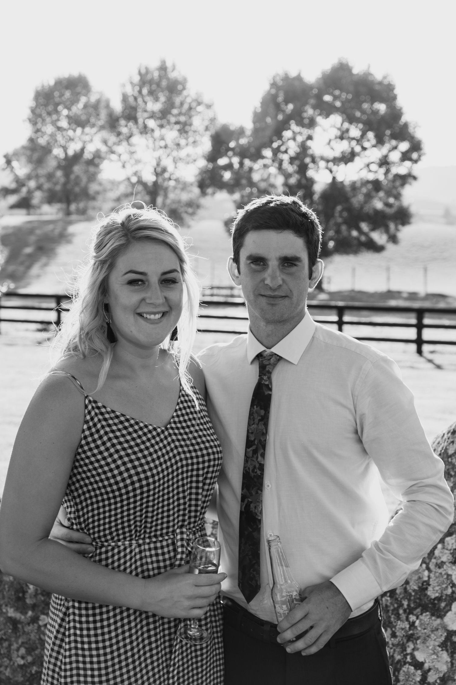 wedding-at-the-red-barn-new-zealand-wedding-photographer-guests-at-sunset-together.jpg