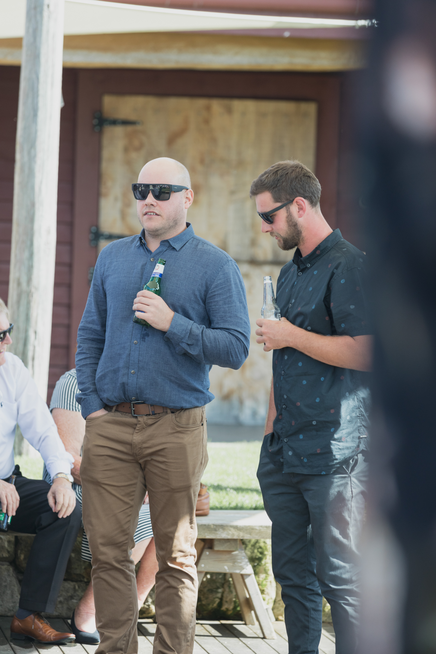 wedding-at-the-red-barn-new-zealand-wedding-photographer-guests-greeting-eachother.jpg