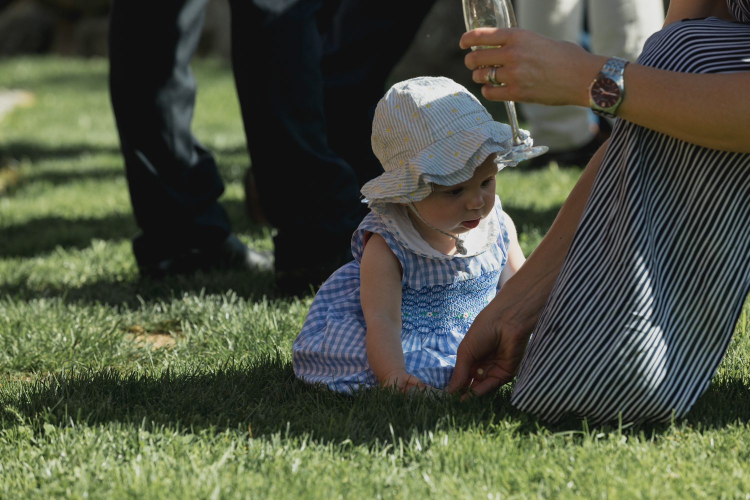 wedding-at-the-red-barn-new-zealand-wedding-photographer-little-girl-playing-in-grass.jpg