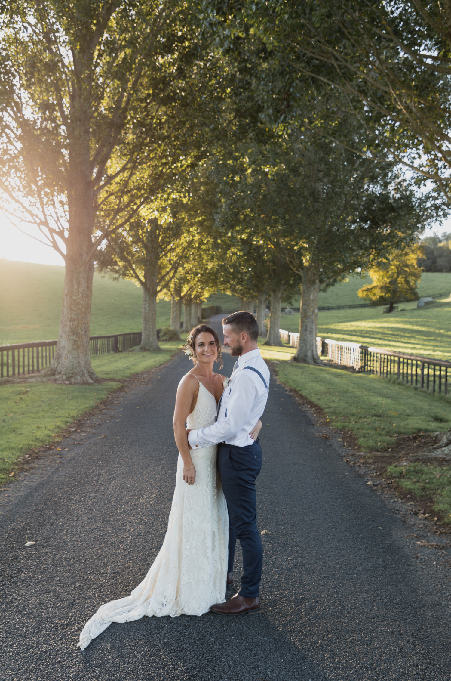 wedding-at-the-red-barn-new-zealand-wedding-photographer-on-tree-lined-driveway-together.jpg