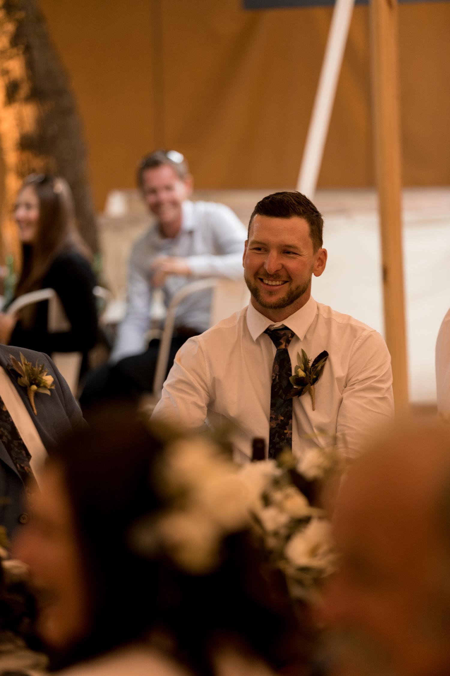 black-barn-winery-wedding-hawkes-bay-wedding-photographer-best-man-laughing.jpg