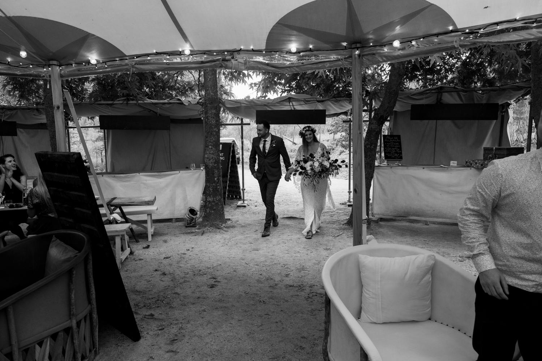black-barn-winery-wedding-hawkes-bay-wedding-photographer-bride-and-groom-entering-reception.jpg
