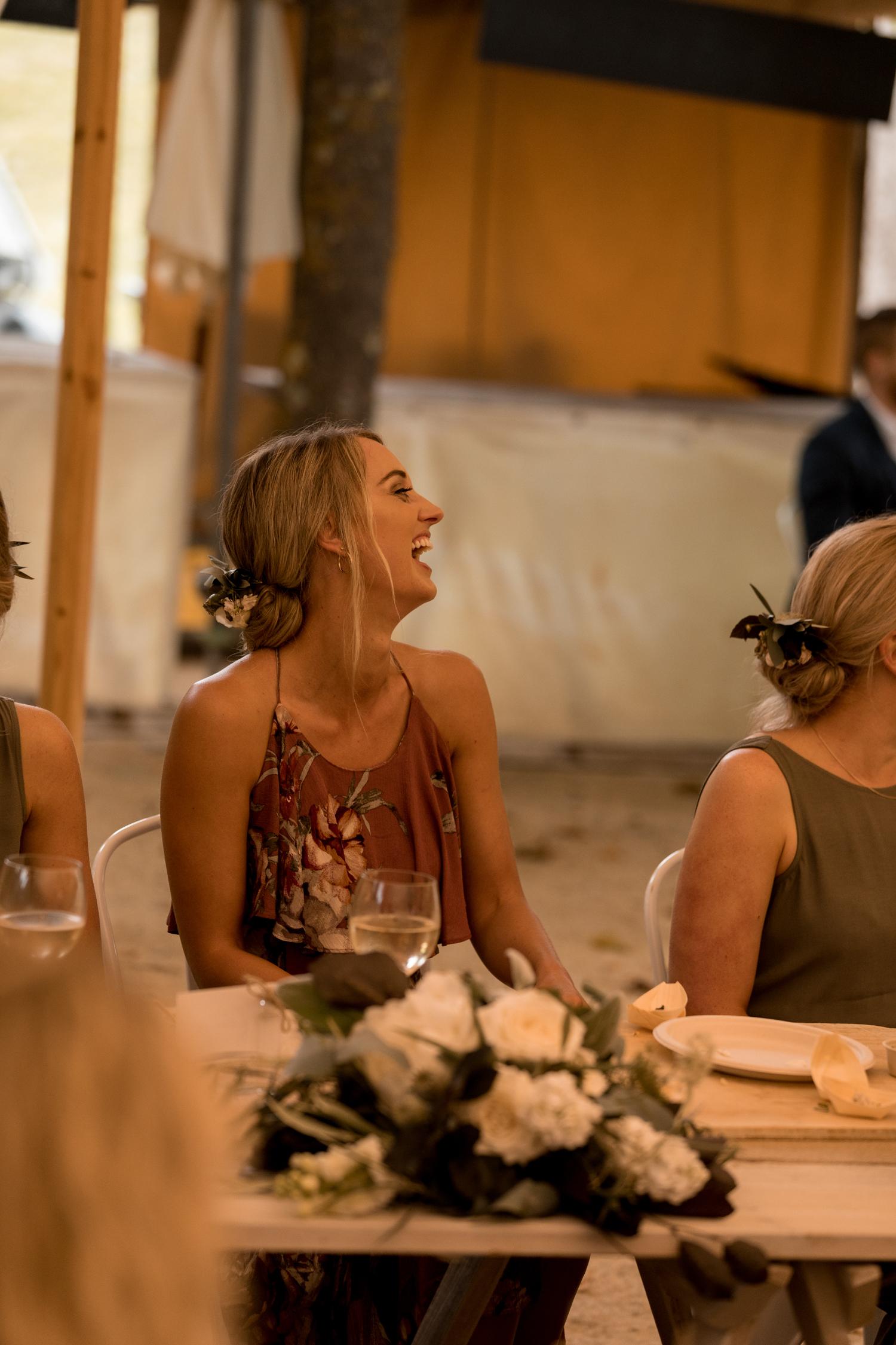 black-barn-winery-wedding-hawkes-bay-wedding-photographer-bridesmaid-laughing.jpg