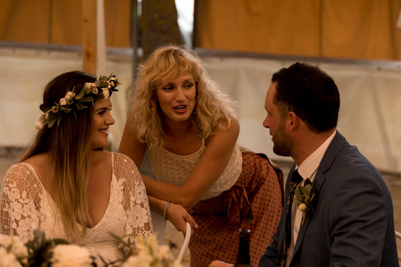 black-barn-winery-wedding-hawkes-bay-wedding-photographer-friend-talking-to-bride-and-groom.jpg