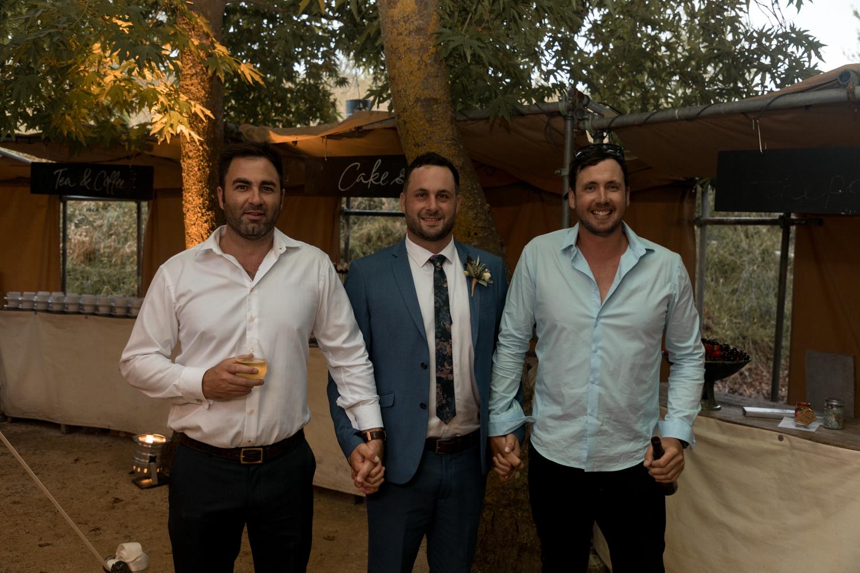 black-barn-winery-wedding-hawkes-bay-wedding-photographer-groom-with-friends.jpg
