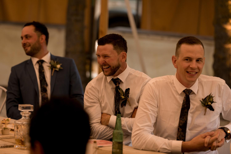 black-barn-winery-wedding-hawkes-bay-wedding-photographer-groomsmen-laughing.jpg