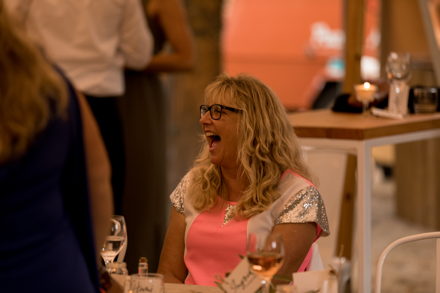 black-barn-winery-wedding-hawkes-bay-wedding-photographer-guest-in-hot-pink-dress-laughing.jpg