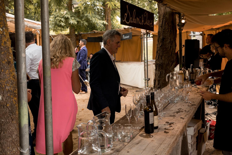 black-barn-winery-wedding-hawkes-bay-wedding-photographer-guests-getting-drinks.jpg