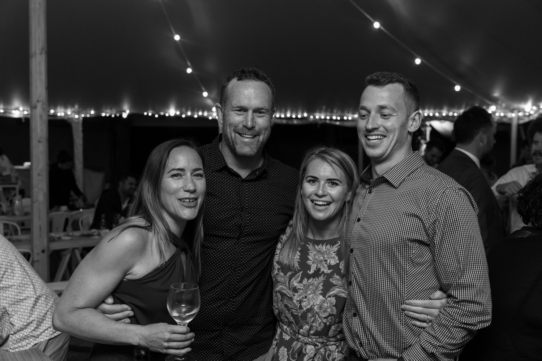 black-barn-winery-wedding-hawkes-bay-wedding-photographer-guests-laughing-at-reception.jpg