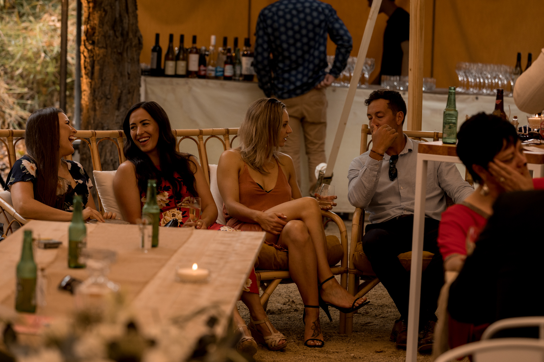 black-barn-winery-wedding-hawkes-bay-wedding-photographer-guests-lougning-on-flock-loungewear.jpg