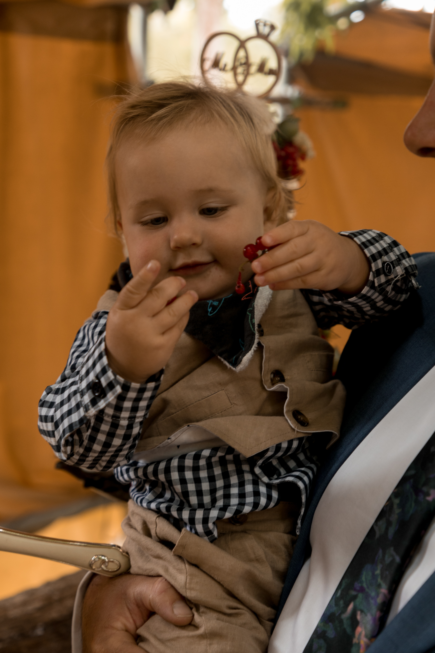 black-barn-winery-wedding-hawkes-bay-wedding-photographer-son-of-bride-and-groom-eating-cake.jpg