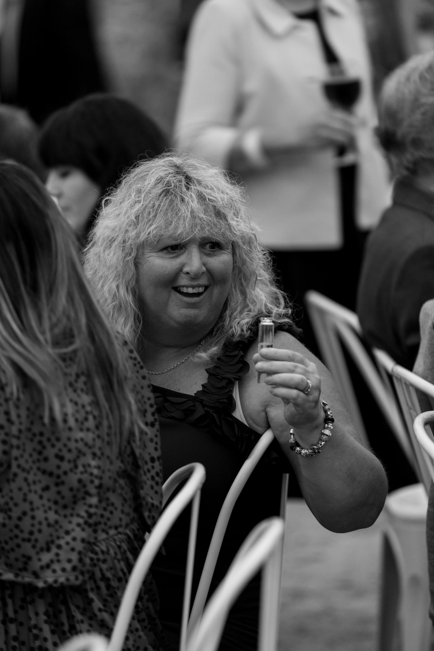 black-barn-winery-wedding-hawkes-bay-wedding-photographer-aunty-doing-shots.jpg