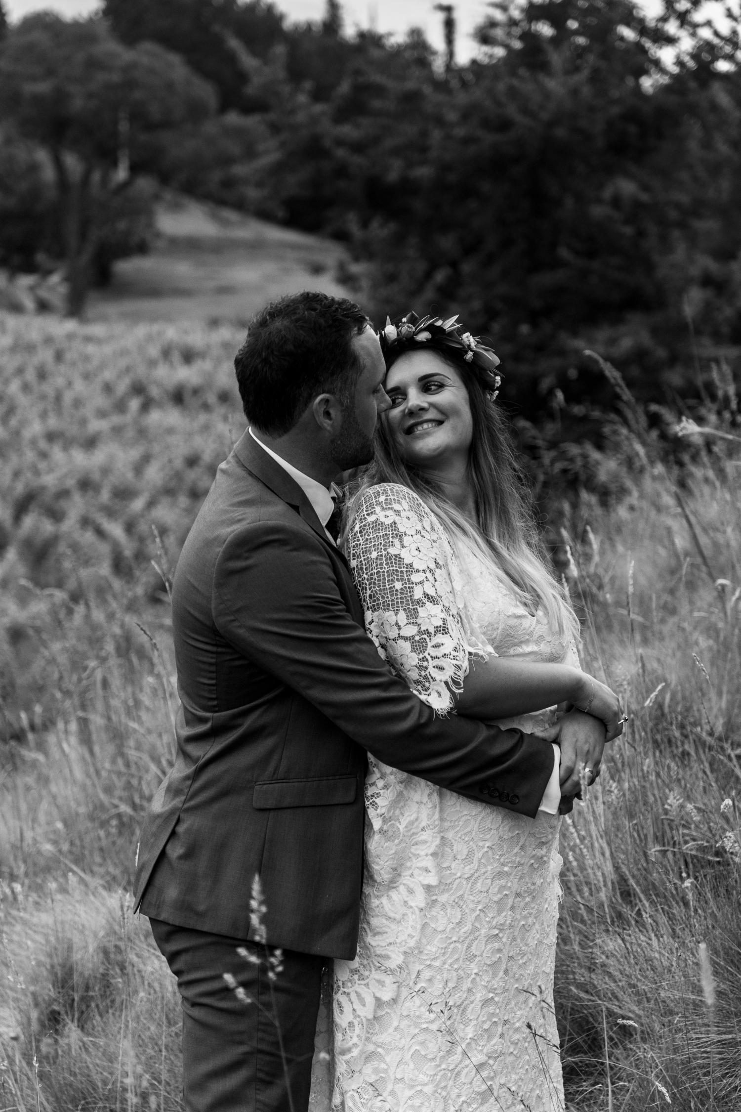 black-barn-winery-wedding-hawkes-bay-wedding-photographer-bride-and-groom-at-sunset-cuddling.jpg