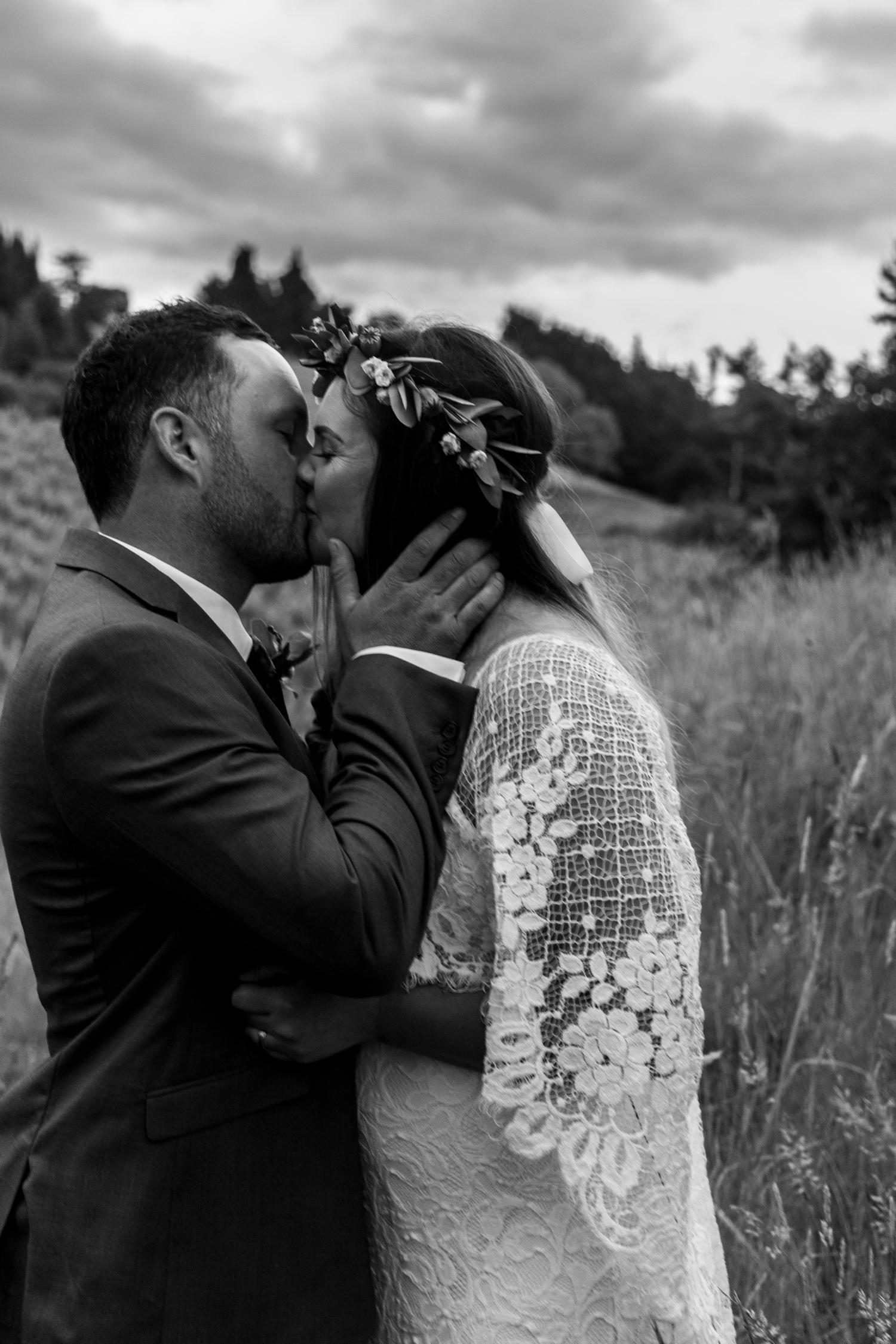 black-barn-winery-wedding-hawkes-bay-wedding-photographer-bride-and-groom-at-sunset-kissing.jpg