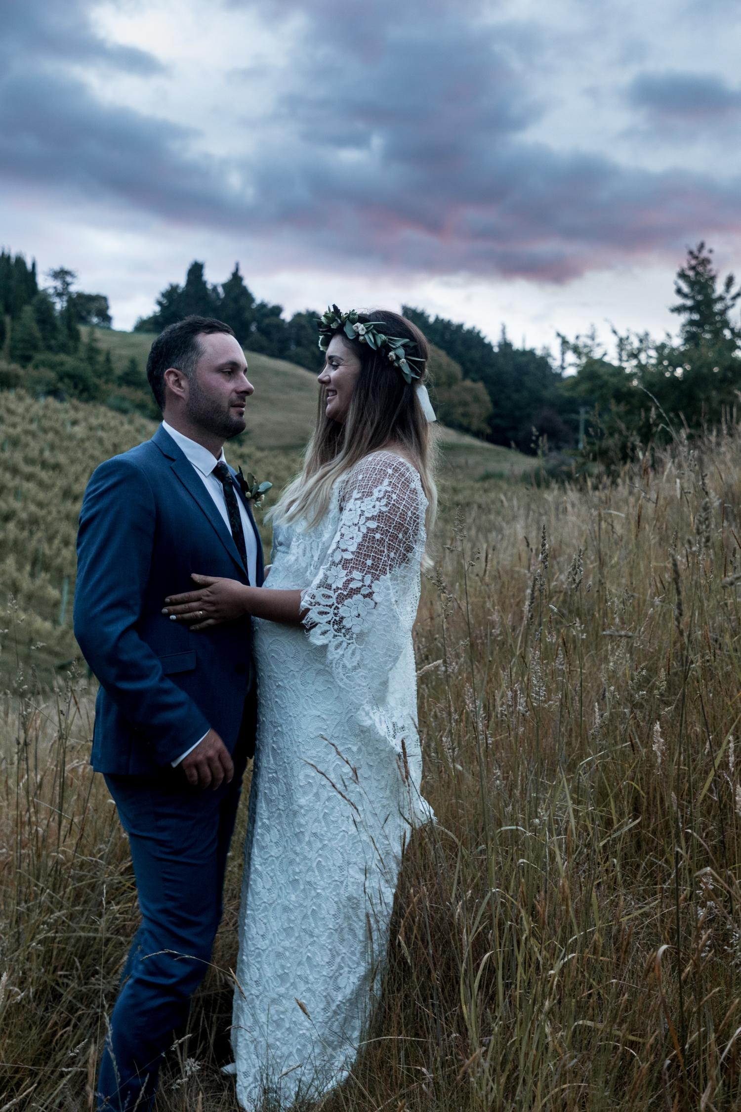 black-barn-winery-wedding-hawkes-bay-wedding-photographer-bride-and-groom-at-sunset-laughing.jpg