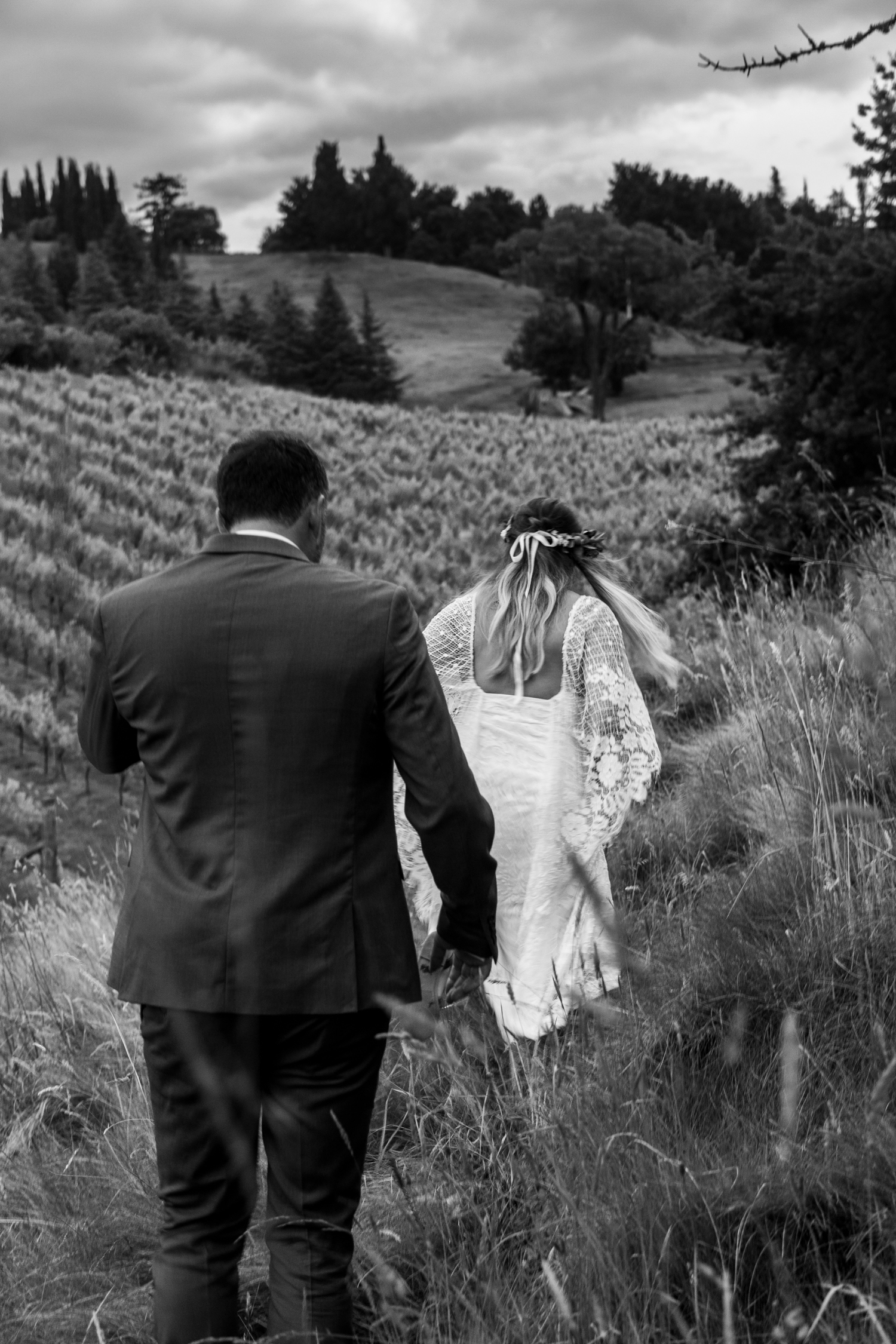 black-barn-winery-wedding-hawkes-bay-wedding-photographer-bride-and-groom-at-sunset-walking-away.jpg