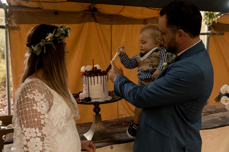 black-barn-winery-wedding-hawkes-bay-wedding-photographer-cutting-sons-birthday0cake.jpg