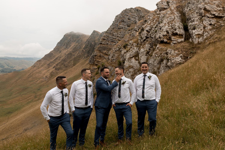 black-barn-winery-wedding-hawkes-bay-wedding-photographer-groom-and-groomsmen-up-te-mata-peak.jpg