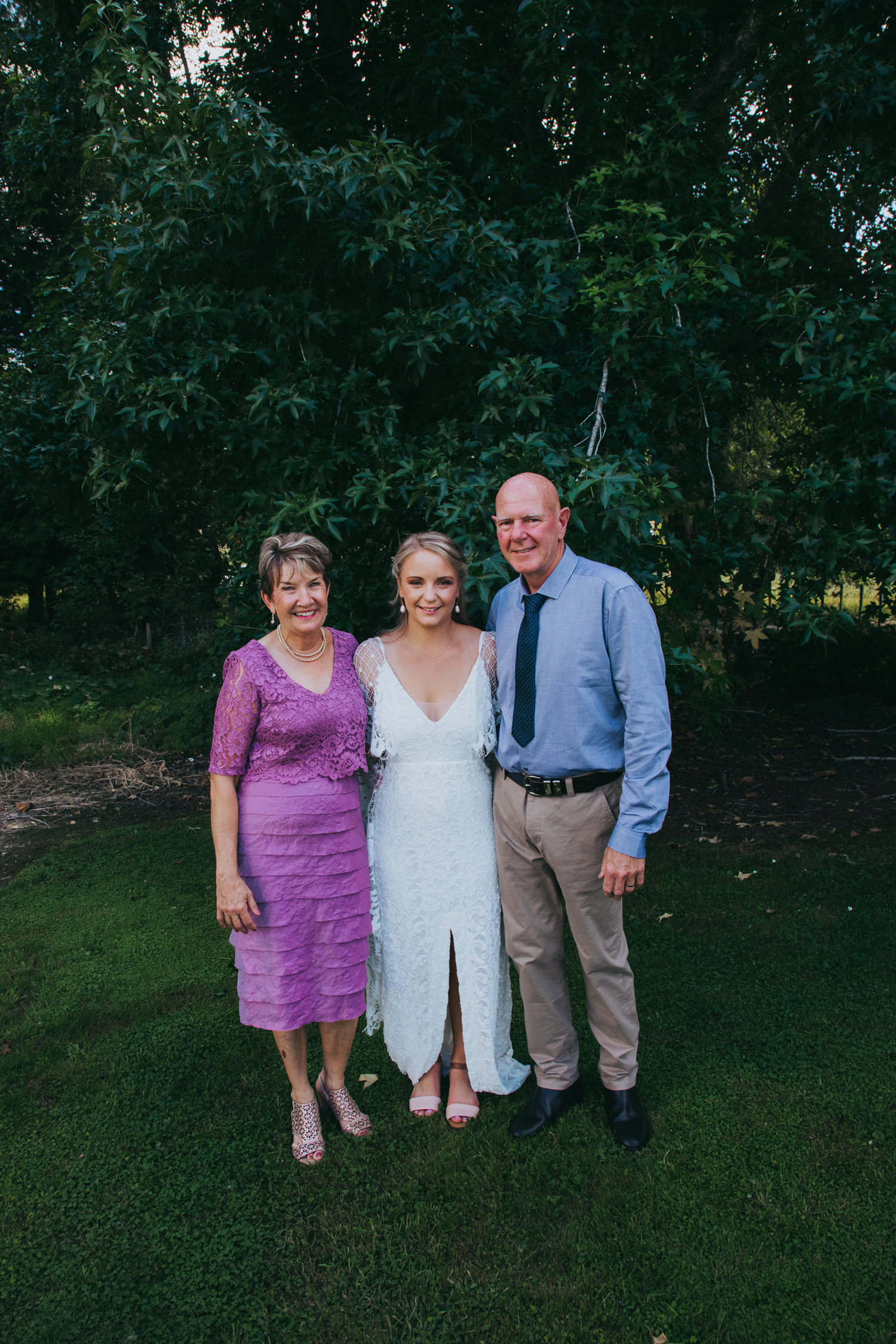 waikato-new-zealand-wedding-photographer-summer-rural-wedding-grace-loves-lace-dress-bride-with-her-parents.jpg