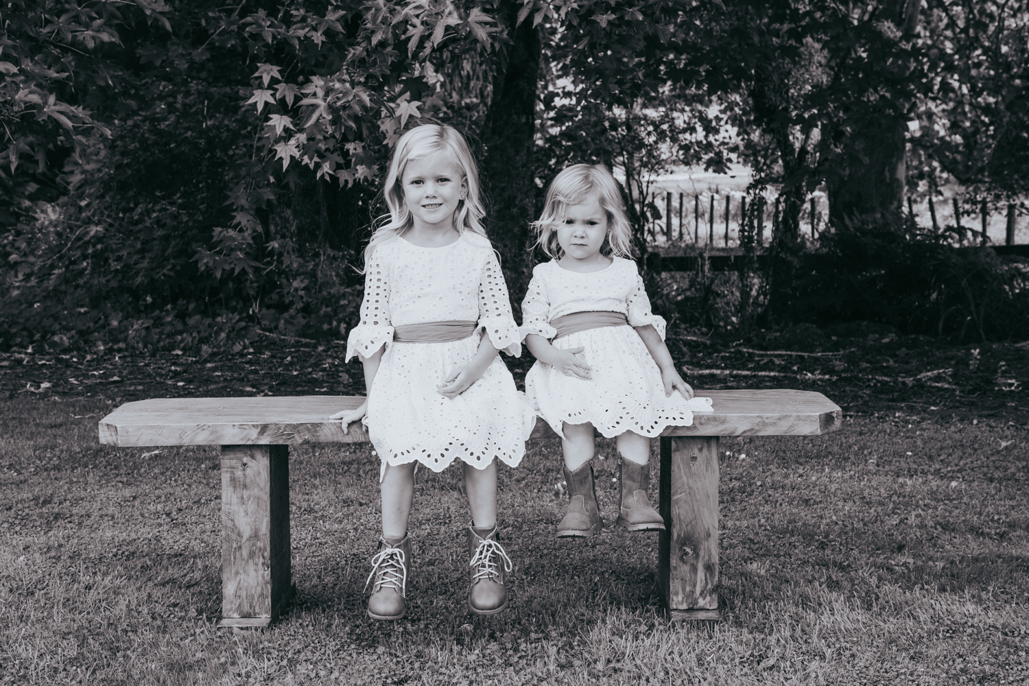 waikato-new-zealand-wedding-photographer-summer-rural-wedding-grace-loves-lace-dress-flower-girls-sitting-together.jpg