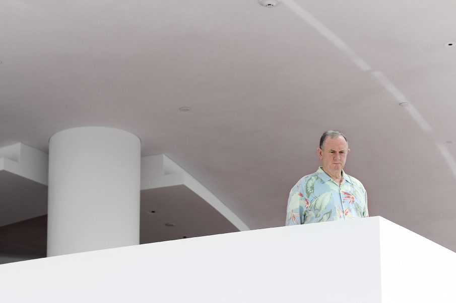 man-in-floral-looking-down-from-balcony_905.JPG