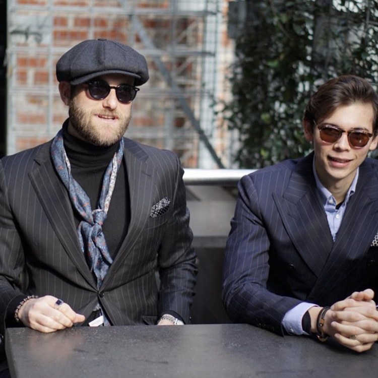 Black pinstriped suit by SD (left)