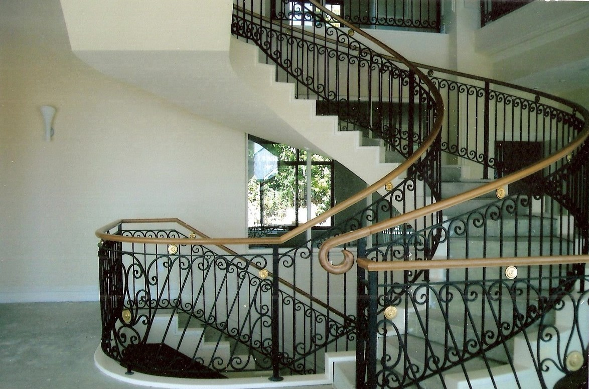 13 - Timber handrail on curved wrought-iron staircase.jpg