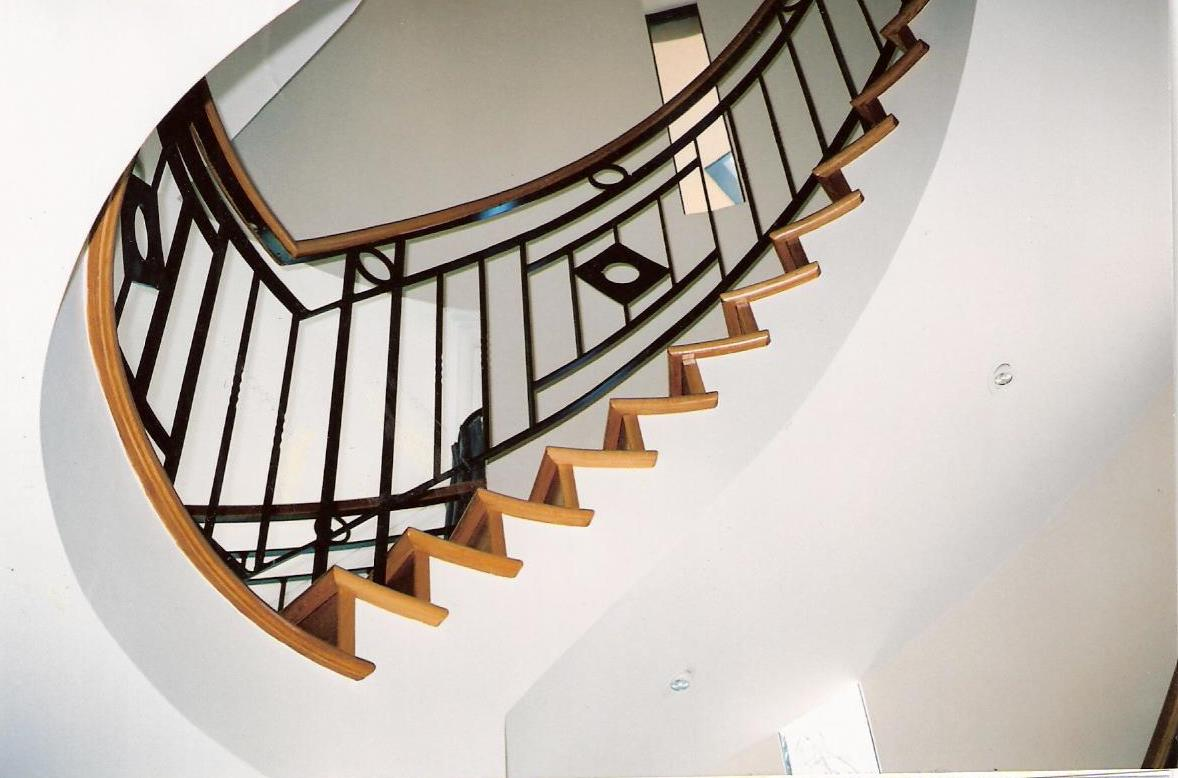 11 - Timber treads on cement, timber handrail on curved wrought-iron staircase.jpg