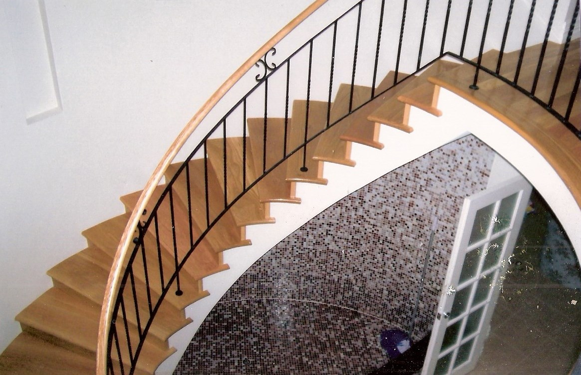 5 - Timber treads on cement, timber handrail on curved wrought-iron staircase.jpg