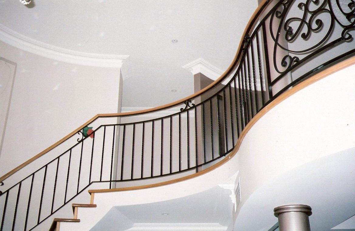 10 - Timber treads on cement, timber handrail on curved wrought-iron staircase.jpg