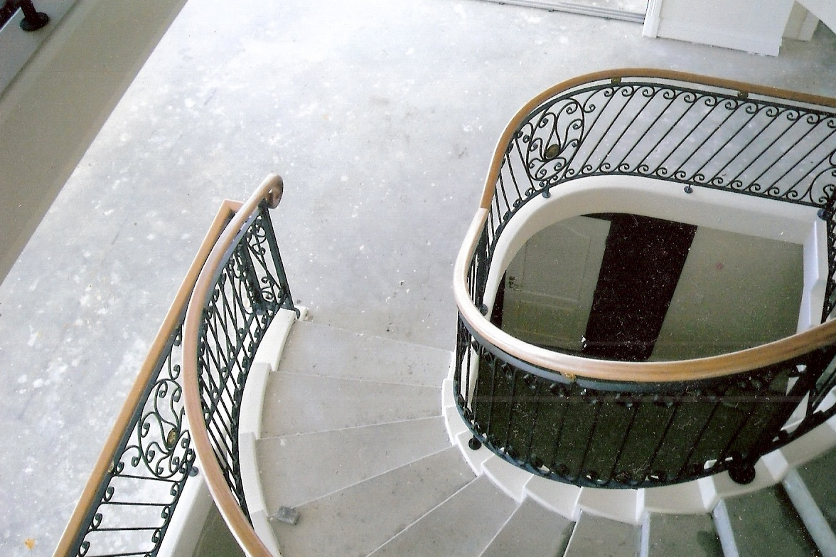 12 - Timber handrail on curved wrought-iron staircase.jpg