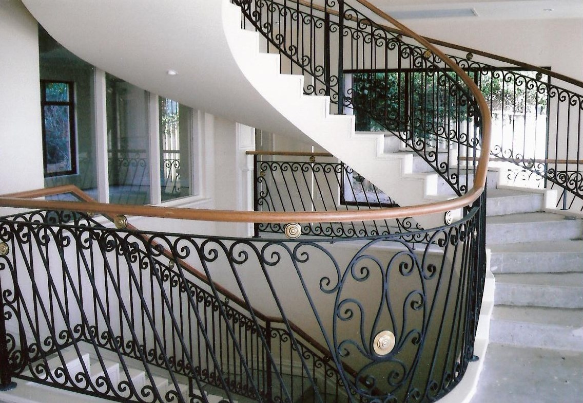 14 - Timber handrail on curved wrought-iron staircase.jpg