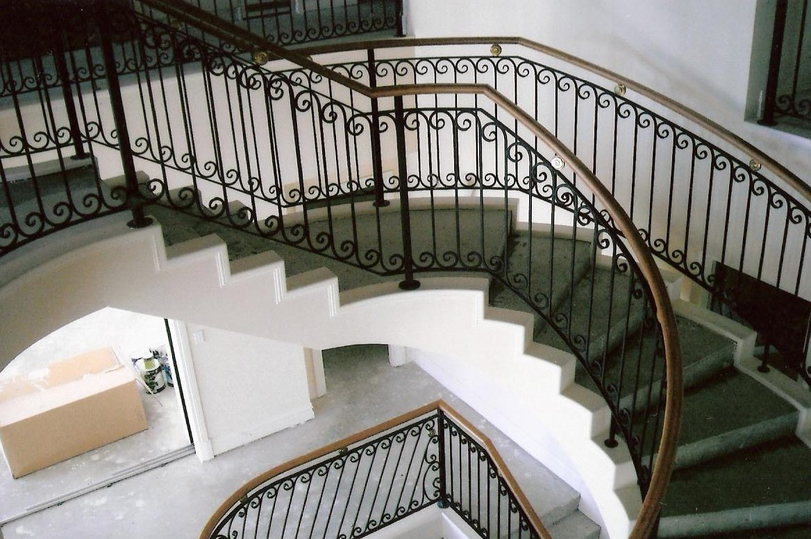 15 - Timber handrail on curved wrought-iron staircase.jpg