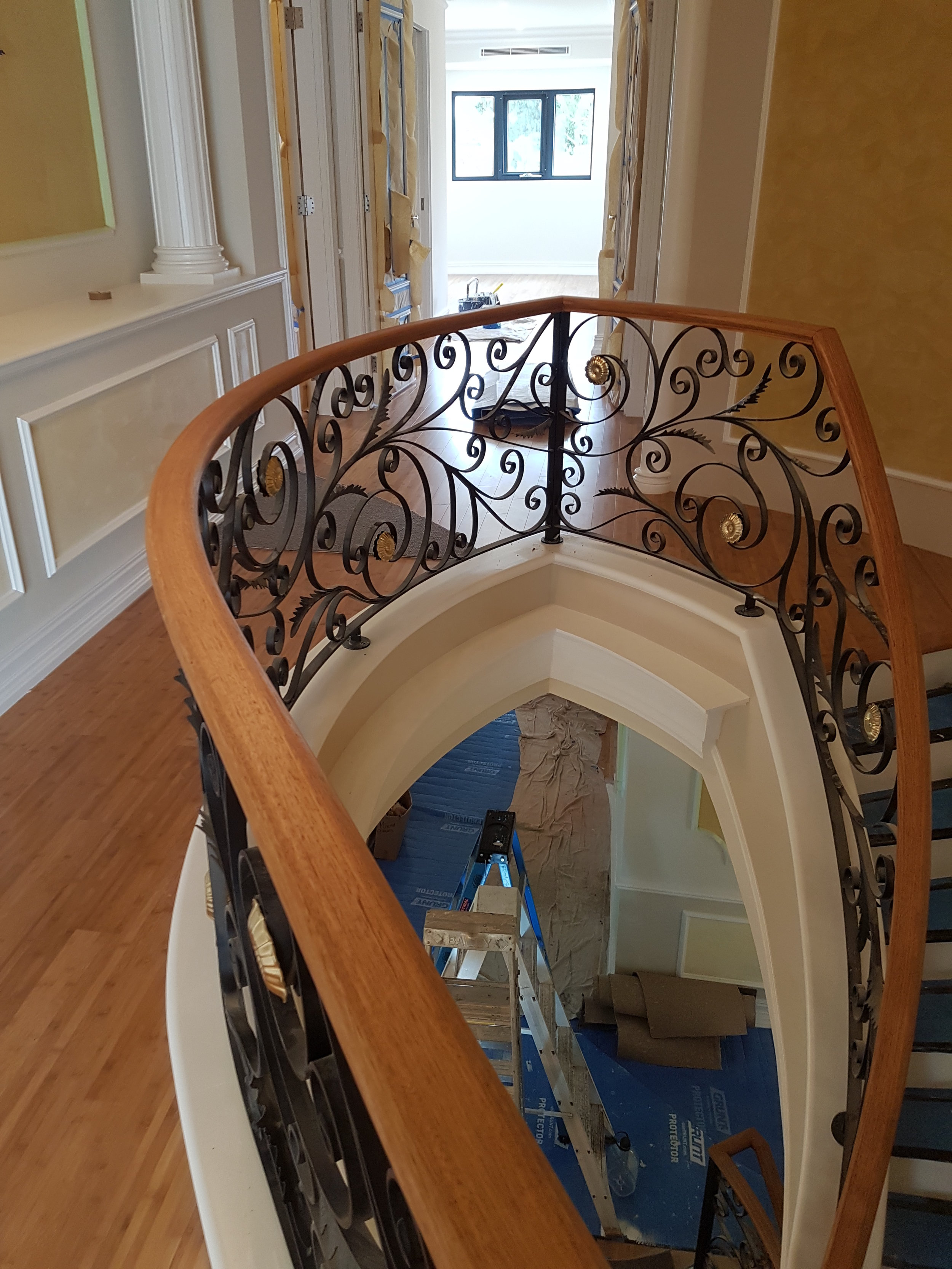 26 - Timber handrail on curved wrought-iron staircase.jpg