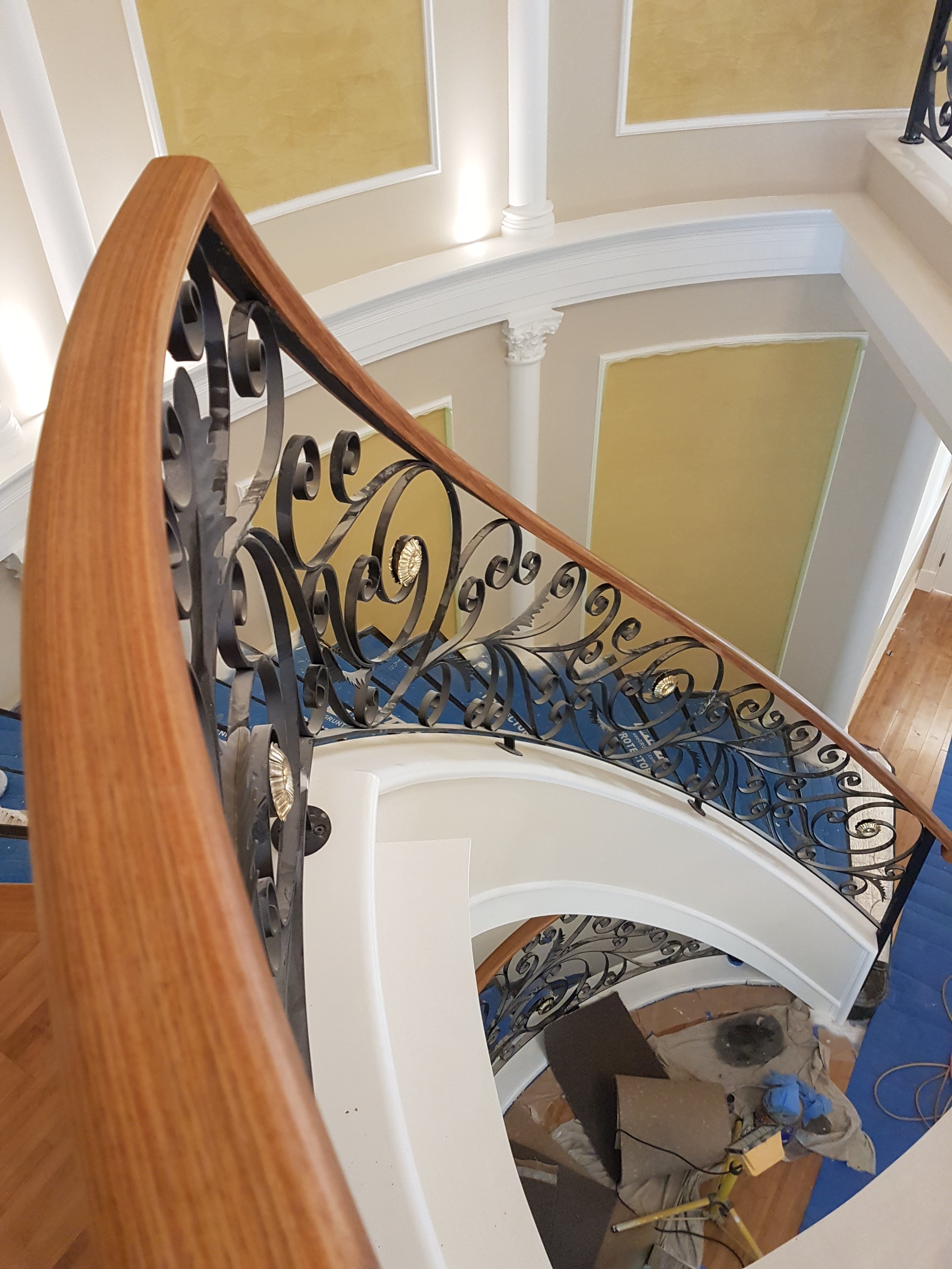 25 - Timber handrail on curved wrought-iron staircase.jpg