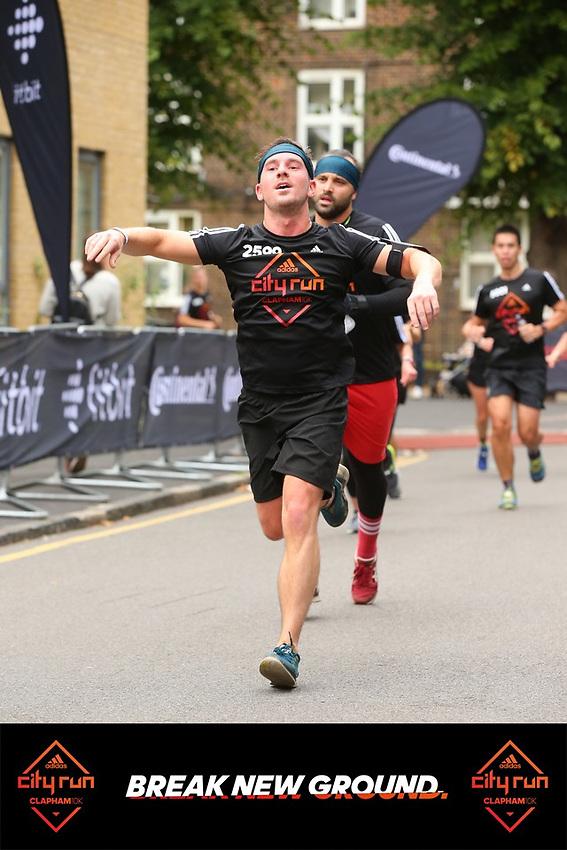 Glenn crossing the finish line in the City Run Clapham
