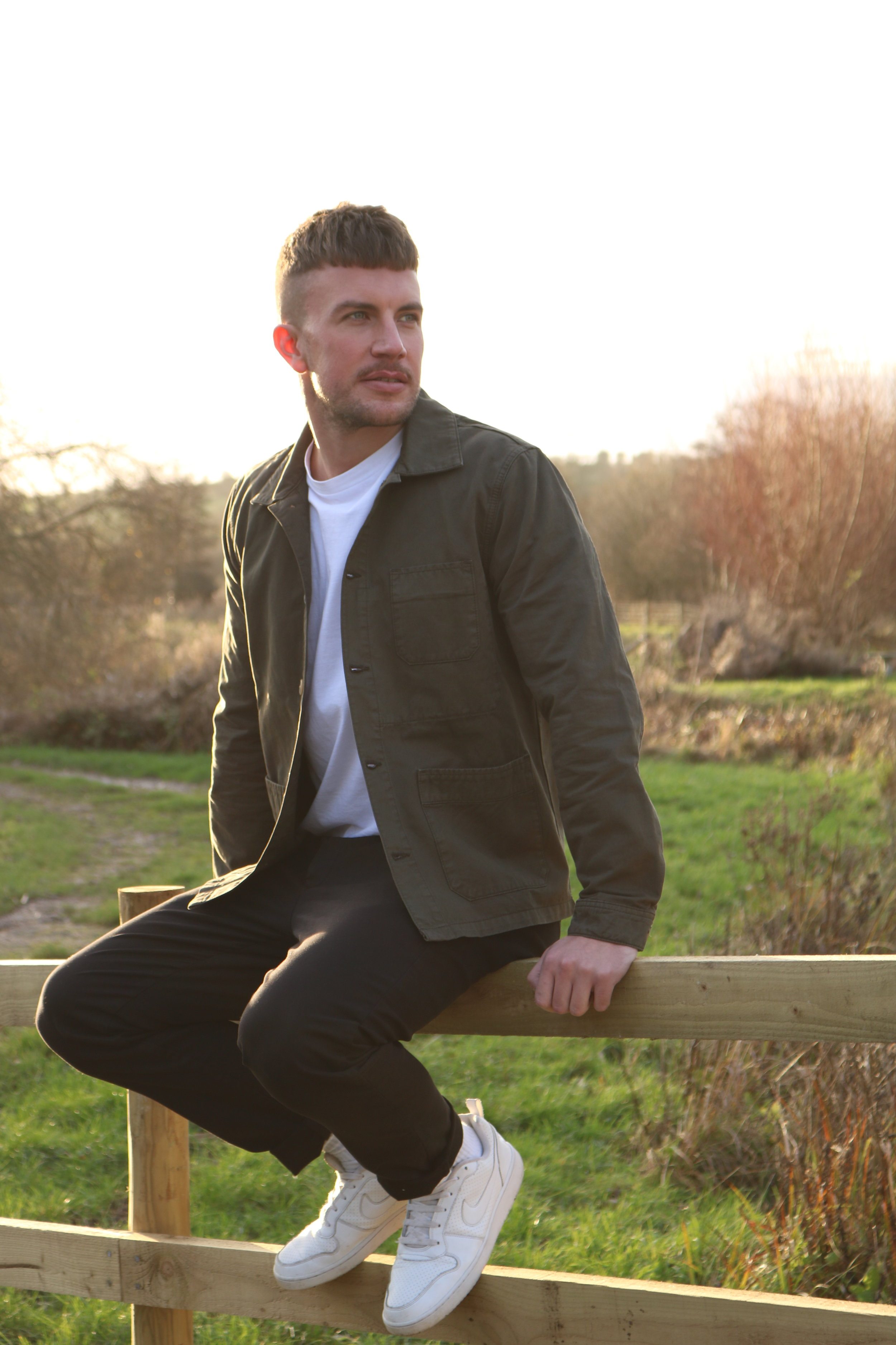 White T-Shirt with High Neck ,  Field Jacket in Military Green ,  Tapered Trousers in Black ,