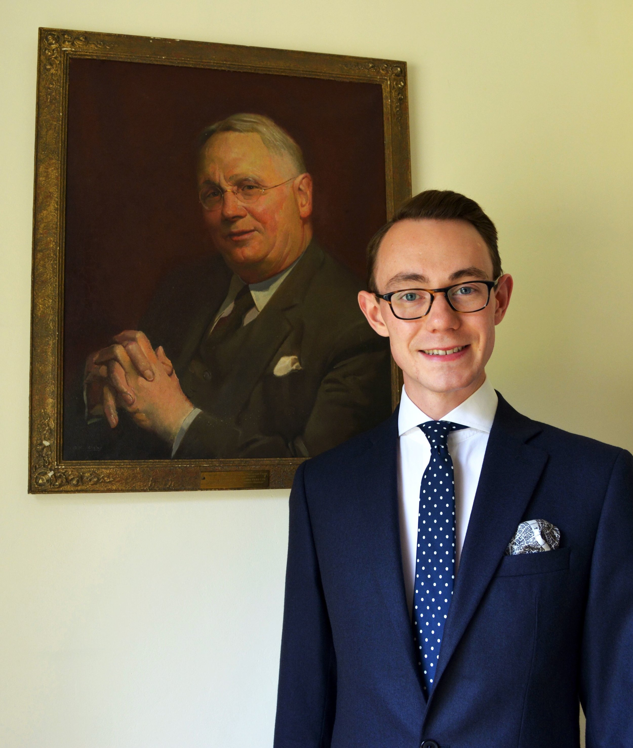 Nicholas Bowman-Scargill with painting of Great-Grandfather