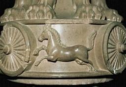 Horse motif on base