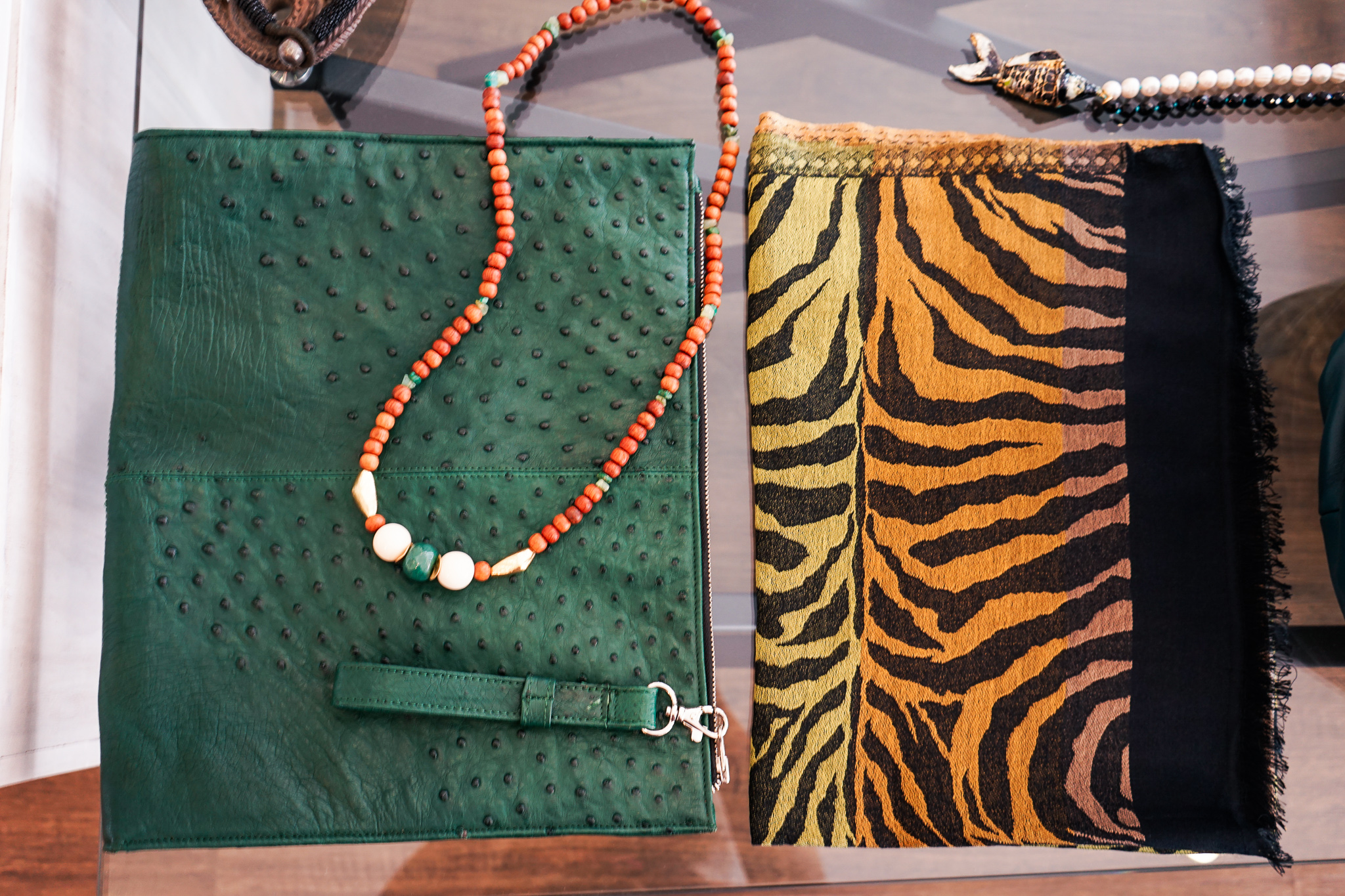 Ostrich leather clutches at L'Atelier Touche