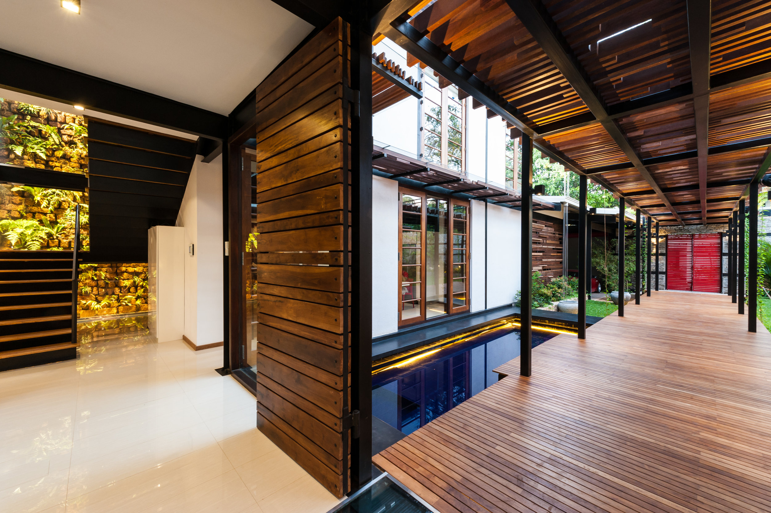 House No. 8 - raised timber walkway into building