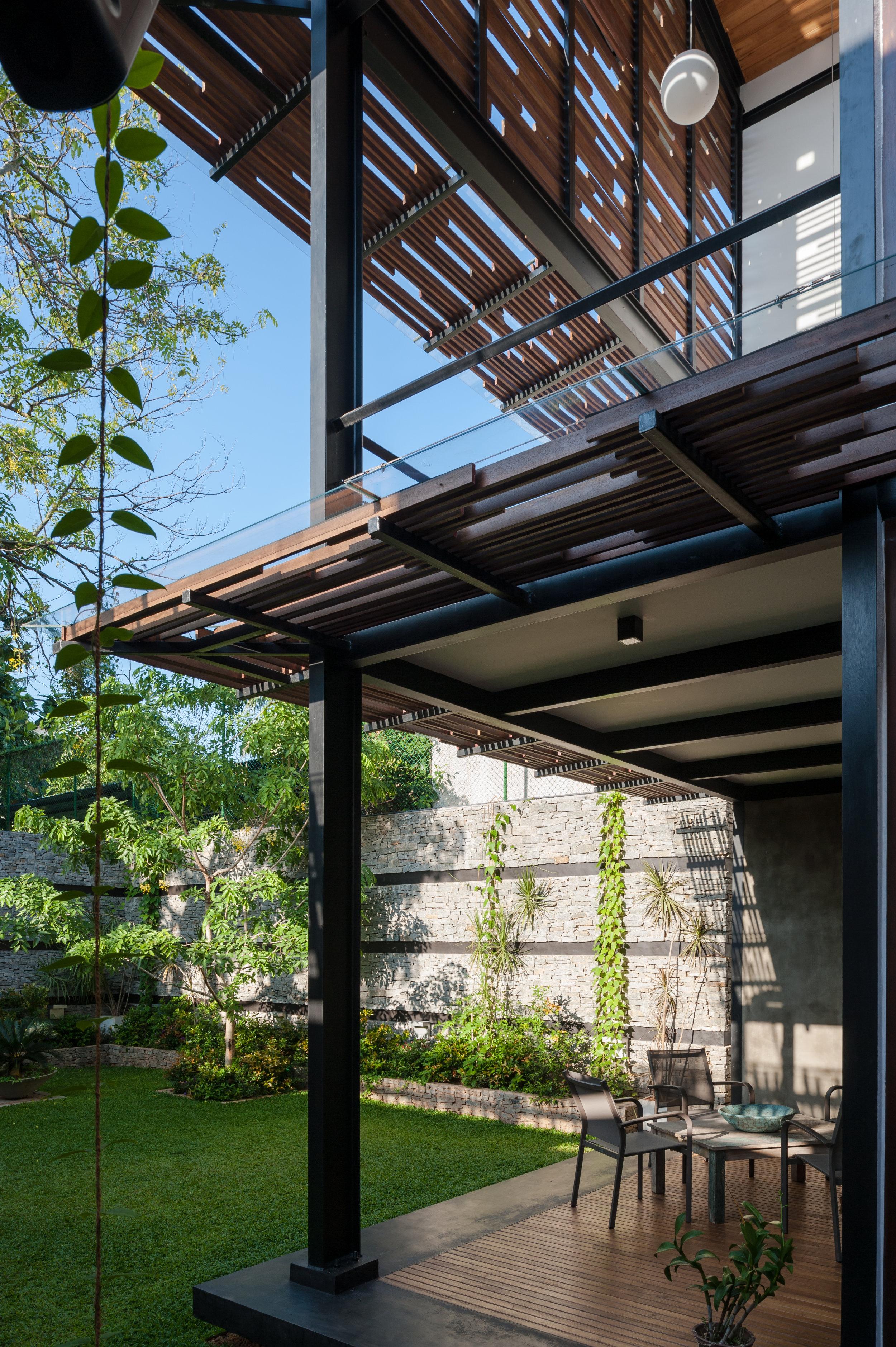 House No. 8 - verandah and backyard