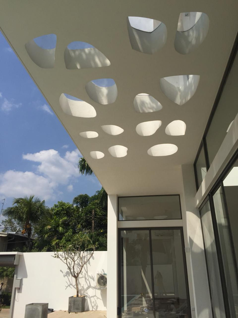 Rajagiriya project - a cantilevered perforated slab over the verandah/pool to facilitate shadow-play in a contemporary way without the use of columns