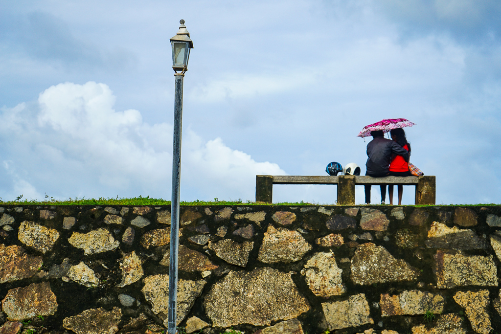 A couple sharing a moment on top of the Galle Fort ramparts