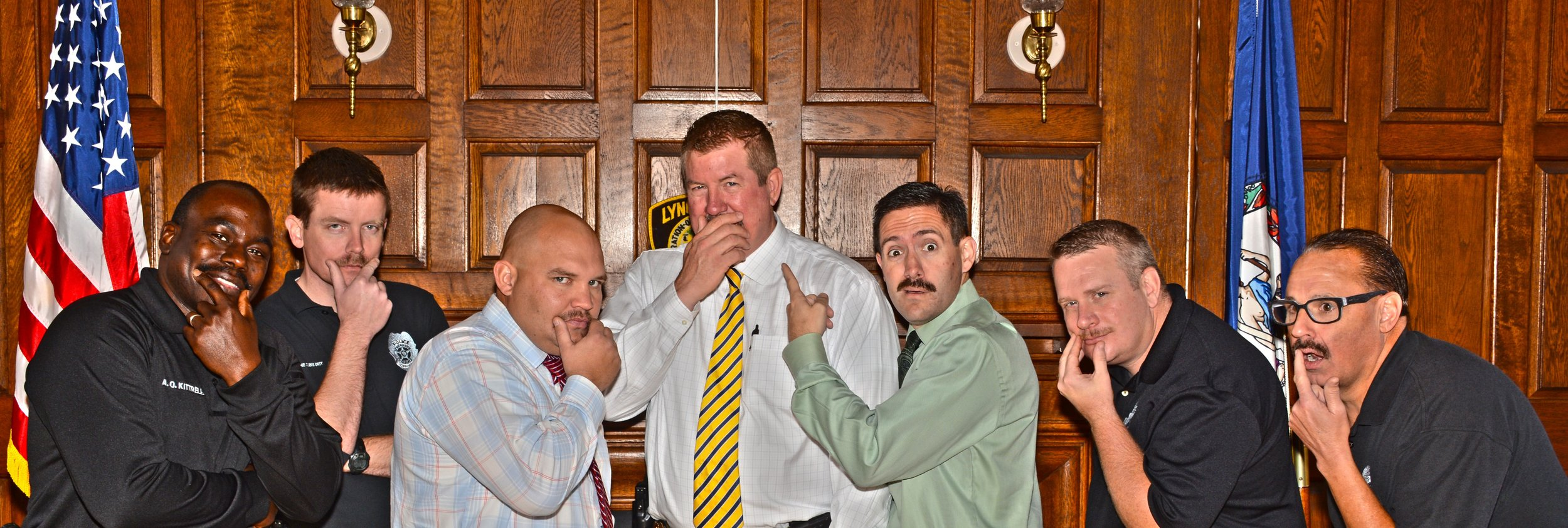 Lynchburg Police Department show off their mustaches during M4K 2015