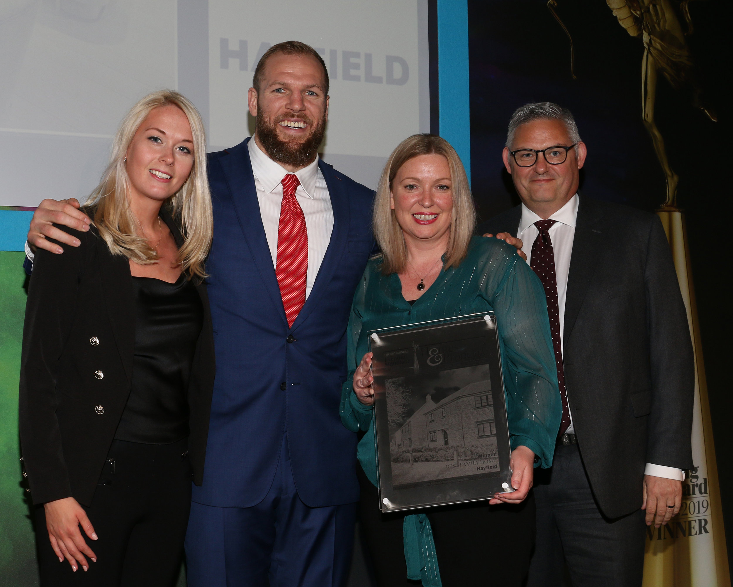 Maddie Robinson, Kelly Sharman and Mark Booth from Hayfield receive the Evening Standard award for Best Family Home from James Haskell.jpg