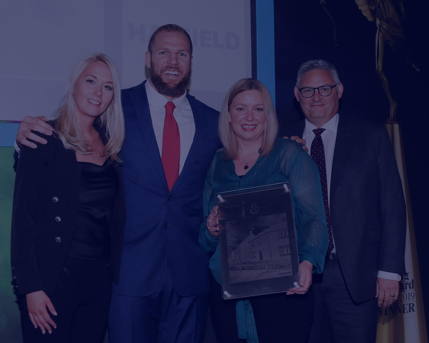 Maddie+Robinson,+Kelly+Sharman+and+Mark+Booth+from+Hayfield+receive+the+Evening+Standard+award+for+Best+Family+Home+from+James+Haskell+blue.jpg