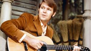 Glen Campbell, country crooner, playing guitar on a porch.  Silver Screen Entertainment/ArchivePhotos